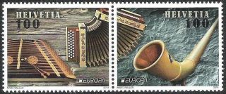Switzerland: Mi 2349 - 50 Europa - Cept: Folk Music Intruments (2014) photo