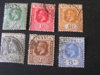 Nigeria,  Scott 18 - 21 (4) +23+26.  Total 6 Kgv 1921 - 33 Die I I Issue photo