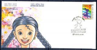 J350 - India 2009.  National Girl Child Day.  Running.  Children.  Flowers. photo