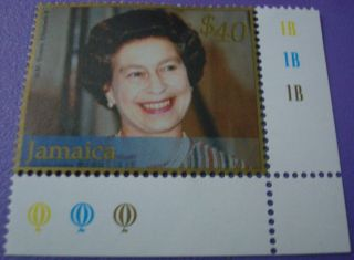 H.  M.  Queen Elizabeth 11 Wearing Pearls And Stripe Dress Jamaica Stamp photo
